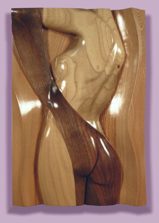 Thomas Haney's Intarsia Torso Twist sculpture of poplar, walnut, and ash of the side view of a releif hand carved woman